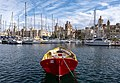 Small boat at the Senglea waterfront with Birgu in the background, Malta (PPL1-Corrected) julesvernex2.jpg