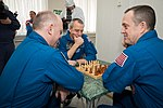 Soyuz MS-08 crew members share a game of chess.jpg