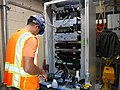 Splicing fiber optic cables in a communications cabinet in a power facility in Queens. 10-02-2019 (48844065016).jpg