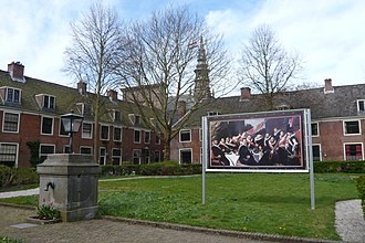 Proveniershuis - A reproduction of Frans Hals' first schutterstuk in the garden. The church tower in the distance is the Nieuwe Kerk, Haarlem.