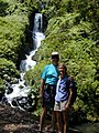 Starr-010715-0026-Spathodea campanulata-habitat with Peter and Harriet by waterfall-Wahinepee-Maui (24532994425).jpg