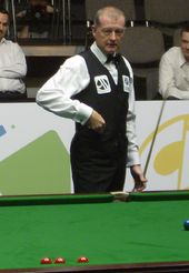 picture of Steve Davis reaching for chalk