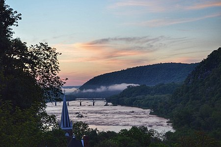 Sunrise view from Jefferson Rock at Harpers Ferry, WV. (In the distance is the Sandy Hook Bridge over the Potomac River that connects Maryland (left bank) with Virginia along U.S. Highway 340.) Sunrise View from Jefferson Rock.jpg
