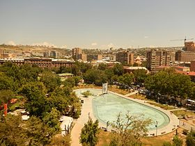 Swan lake with Yerevan panorama.jpg