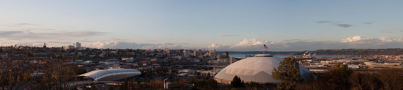 Panorama of Tacoma from the McKinley neighborhood with the Tacoma Dome in the foreground and Puget Sound in the background.