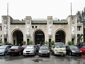 "Tanjong Pagar railway station - The art deco Tanjong Pagar Railway Station. The large initials ""F M S R"" stand for Federated Malay States Railways. The four white marble reliefs beneath these initials are allegories of Agriculture, Commerce, Transport and Industry."