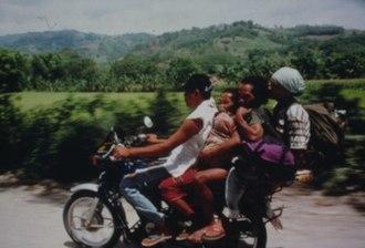 Tasaday - Tasadays riding on a motorbike.