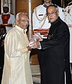 The President, Shri Pranab Mukherjee presenting the Padma Vibhushan Award to Shri Bellur Krishnamachar Sundararaja Iyengar, at an Investiture Ceremony-II, at Rashtrapati Bhavan, in New Delhi on April 26, 2014.jpg