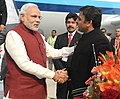 The Prime Minister, Shri Narendra Modi being received by the Chief Minister of Uttar Pradesh, Shri Akhilesh Yadav, on his arrival at Varanasi airport, Uttar Pradesh on November 25, 2014.jpg