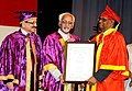 """The Vice President, Shri Mohd. Hamid Ansari presenting the award to the Chairman, Economic Advisory Council to PM, Dr. C. Rangarajan, at the """"12th Convocation of University of Hyderabad"""", in Hyderabad on June 22, 2010.jpg"""
