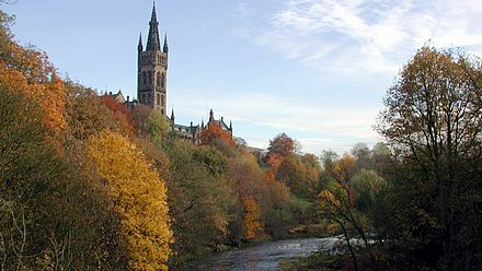 The university's tower overlooking Kelvingrove Park, as seen from Partick Bridge over the River Kelvin Tower of The University of Glasgow.jpg