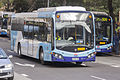 Transport NSW liveried (2476 ST), operated by Sydney Buses, Custom Coaches CB80 bodied Scania K280UB on Loftus Street in Circular Quay.jpg