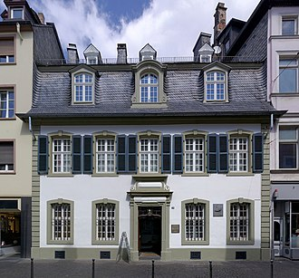 Karl Marx - Marx's birthplace, now Brückenstraße 10, in Trier. The family occupied two rooms on the ground floor and three on the first floor. Purchased by the Social Democratic Party of Germany in 1928, it now houses a museum devoted to him
