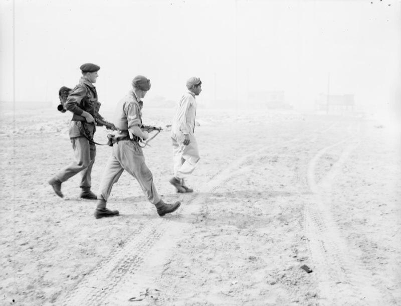 Troops of 3rd Battalion Parachute Regiment escort a captured Egyptian soldier on the beach at Port Said
