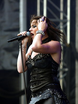 Floor Jansen - Jansen live with Nightwish in 2013, before being promoted to regular member later that year