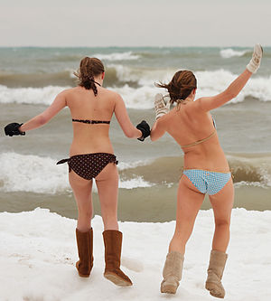 Polar bear plunge - Two women prepare to enter the water in Milwaukee.