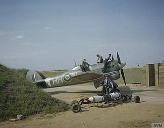 "Hawker Typhoon - Typhoon Ib EK139 N ""Dirty Dora"" of 175 Sqn. being armed with ""500 lb"" concrete practice bombs in late 1943."