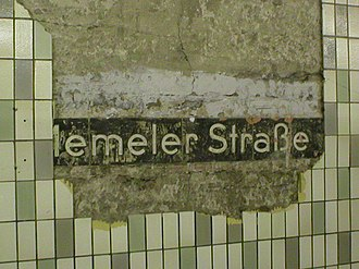 Weberwiese (Berlin U-Bahn) - Falling tiles reveal the original station name before renovation in 2003