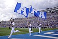U.S. Air Force Academy (USAFA) junior Joseph Flescher, left, leads the USAFA banners across the end zone after a touchdown during the USAFA Falcons football game against the Idaho State Bengals at Falcon Stadium 120901-F-JM997-804.jpg