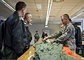 U.S. Air Force Master Sgt. Gary Randall, right, an aircrew flight equipment technician with the 52nd Operations Support Squadron, demonstrates parachute packing to members of the Romanian air force during 140326-F-NJ596-039.jpg
