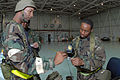 U.S. Air Force Tech. Sgt. Juan McCoy, with the 169th Aircraft Maintenance Squadron, scans Senior Airman Keith Moore's identification card at a flightline entry control point during a phase II operational 080412-F-WT236-052.jpg
