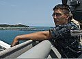 U.S. Navy Seaman Nathaniel Bird stands lookout on the bridge wing of the amphibious dock landing ship USS Tortuga (LSD 46) as the ship approaches the pier April 23, 2013, at White Beach in Okinawa, Japan 130423-N-IY633-133.jpg