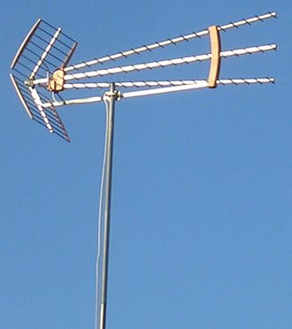 Corner reflector antenna - Modern UHF TV antenna consisting of 3 Yagi arrays in front of a common corner reflector.