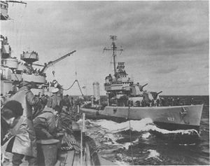 USS Thompson refuels from the battleship USS Arkansas (BB-33) in April 1944, while rehearsing for the invasion of Normandy.