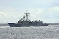 US Navy 030329-N-2143T-007 The guided missile frigate USS Rodney M. Davis (FFG 60) steams alongside aircraft carrier USS Nimitz (CVN 68).jpg