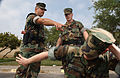 US Navy 030416-N-5862D-189 Master-at-Arms 1st Class Timothy Fite instructs Hull Technician 2nd Class Brad Hurshey, a member of the Auxiliary Security Force (ASF) on proper handcuffing techniques.jpg