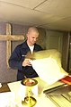 US Navy 030514-N-0413R-006 Religious Program Specialist Seaman Derek Arnold of Ripon, Wis., prepares for a Catholic mass in the Chapel aboard USS Nimitz (CVN 68).jpg