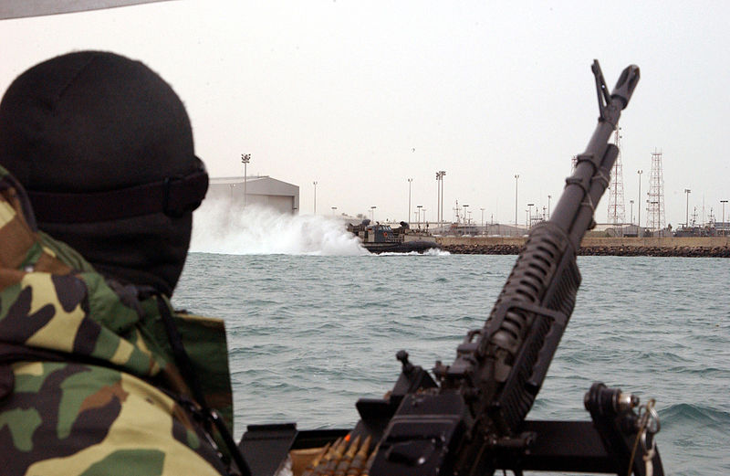 File:US Navy 040222-N-0401E-030 Crewmembers aboard a patrol craft assigned to Coast Guard Port Security Unit Three Zero Seven (PSU 307) monitor activities around Kuwait Naval Base.jpg