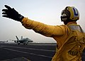 US Navy 040516-N-1045B-092 Aviation Boatswain's Mate 3rd Class Sam Vasquez of Craig, Colo., directs an F-A-18C Hornet.jpg