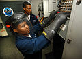 US Navy 040529-N-6278K-083 Electrician's Mate Fireman Lashaya Thomas of Philadelphia, Pa. and Electrician's Mate 3rd Class Dawane Martinez of Rochester, N.Y., check the voltage in a circuit panel aboard USS George Washington (C.jpg
