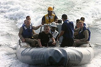 Rescue swimmer - Surface Search and Rescue Swimmer assisting in the transfer of midshipmen