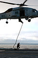 US Navy 040619-N-2788L-208 Members assigned to Explosive Ordnance Disposal Mobile Unit Eleven (EODMU-11) exit an SH-60F Seahawk.jpg