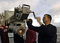 US Navy 041031-N-0499M-051 A Fire Controlman loads a RIM-7 NATO Sea Sparrow missile during a launcher upload evaluation aboard the Nimitz-class aircraft carrier USS Abraham Lincoln (CVN 72).jpg