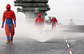 US Navy 050127-N-7130B-051 Flight deck personnel check the sprinkler system on the flight deck of USS Ronald Reagan (CVN 76) during a flight deck countermeasure washdown.jpg