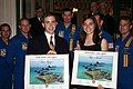 US Navy 050401-N-2360K-014 James Reagan and Rebecca Bennet receive signed lithographs from the U.S. Navy Flight Demonstration Team, Blue Angels, as congratulations for their achievements.jpg
