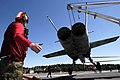 US Navy 050524-N-4166B-002 Flight Deck personnel assigned to Air Department conduct aircraft salvage training.jpg