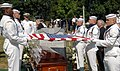 US Navy 050723-N-1026O-005 The American flag draped over the casket of retired Vice Adm. James B. Stockdale is prepared for presentation to the family by a ceremonial guard.jpg