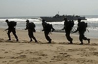 US Navy 051015-F-5789F-040 Ghanaian soldiers run to their positions while engaged in amphibious operations in southwest Ghana during the West African Training Cruise '06 (WATC).jpg