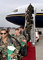 US Navy 051205-N-1132S-018 New fathers assigned to Naval Mobile Construction Battalion Seven Four (NMCB-74) receives flowers as they return home from a six-month deployment to Okinawa, Japan.jpg