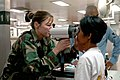 US Navy 060526-N-3714J-021 U.S. Air Force Capt. Jennifer Owen of Birmingham, Ala., conducts an eye exam for a local resident aboard the Military Sealift Command (MSC) hospital ship USNS Mercy.jpg