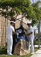 US Navy 060628-N-8921O-044 Commander, Naval Special Warfare Command, Rear Adm. Joseph Maguire, left, accompanied by Force Master Chief Clell W. Breining, unveil a small memorial plaque honoring the eleven U.S. Navy SEALs.jpg