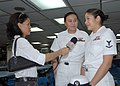 US Navy 070208-N-9860Y-087 Hospital Corpsman 3rd Class Cheryl Stahl and Yeoman 2nd Class Loribelle Valdez, a native of Olangapo, Philippines, are interviewed by a member of the ABS-CBN network to talk about shipboard life.jpg