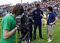US Navy 070418-N-2903M-085 Senior Chief Special Warfare Operator Lance Leafers and Special Warfare Boat Operator 1st Class Dave Fisher of the Navy Parachute Team are interviewed by a student TV news crew after a performance at.jpg