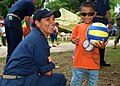 US Navy 070531-N-0120A-188 Ensign Jennifer A. Sanders, assigned to dock landing ship USS Harpers Ferry (LSD 49), plays with a Filipino child during a friendship-building project between Harpers Ferry Sailors and a Zamboanga chi.jpg