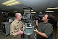 US Navy 070617-N-8704K-136 Brian Ely, of WPLG Channel 10 Miami, interviews Capt. Bruce Boynton, commanding officer of the Medical Treatment Facility aboard the Military Sealift Command hospital ship USNS Comfort (T-AH 20).jpg
