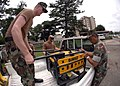 US Navy 070719-N-2560Y-001 Construction Electrician 2nd Class Ryan Nichols and Senior Chief Construction Electrician Alejandro Bautista, of Naval Air Facility Atsugi's Public Works Department, load a portable generator to.jpg